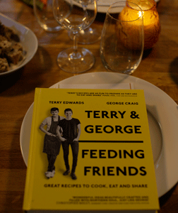 Terry and George Feeding Friends Cook Book